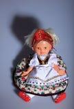 Lovely doll in folk cloth Royalty Free Stock Photos