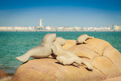 Lovely dugongs sculpture on Hadnamrin beach with blue sky and Ma Stock Image