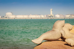 Lovely dugongs sculpture on Hadnamrin beach with blue sky and Ma Royalty Free Stock Image