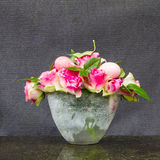 Lovely Easter bouquet of pink eggs and pink roses Stock Photos