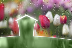 Lovely eco house with colorful flower background Royalty Free Stock Images