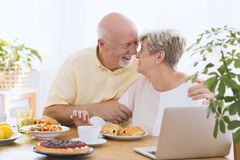 Lovely elderly couple hugging stock images