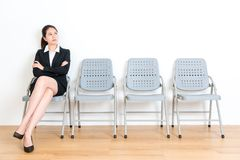 Lovely elegant business girl waiting for interview Royalty Free Stock Image