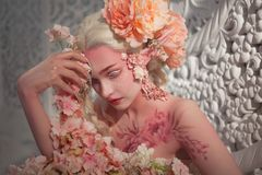 Lovely she-elf among flowers. Creative make-up and bodyart Royalty Free Stock Photo