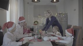 Lovely excited happy family of six celebrating Christmas dinner in festive atmosphere cozy kitchen. Happy lovely excited family of six celebrating Christmas stock video footage