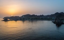 Sunrise in Muscat view from a Ship. Lovely exposure of the city of Muscat at Sunrise, view from a Ship Stock Images