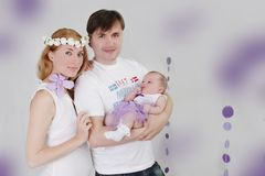 Lovely family with baby girl Royalty Free Stock Image