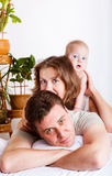 Lovely family in bed Royalty Free Stock Photography
