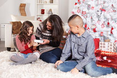Lovely family at Christmas Stock Photos