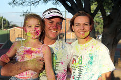 Lovely family covered in powder paint posing Royalty Free Stock Photos