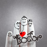 A lovely family hand drawn and finger,doctor and n. Urse,we love doctor concept on texture background Stock Photos