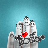 A lovely family hand drawn and finger,doctor and nurse. We love doctor concept Stock Images