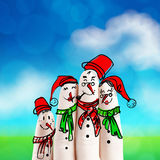 A lovely family hand drawn and finger of snowmen Stock Photos