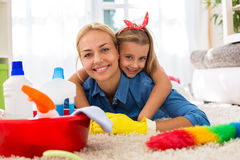 Lovely family having time together and cleaning home Stock Image