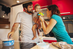 Lovely Family In Kitchen Royalty Free Stock Photo