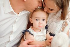 Lovely family smiling and laughing, posing at camera, and hugging each other for family photo. royalty free stock photos