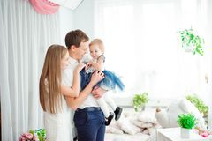 Lovely family smiling and laughing, posing at camera, and hugging each other for family photo. royalty free stock images