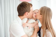 Lovely family smiling and laughing, posing at camera, and hugging each other for family photo royalty free stock photos