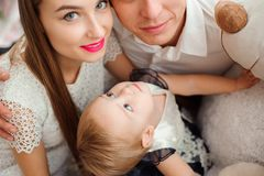 Lovely family smiling and laughing, posing at camera, and hugging each other for family photo. royalty free stock image