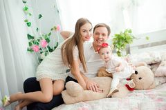 Lovely family smiling and laughing, posing at camera, and hugging each other for family photo. stock photos