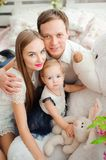 Lovely family smiling and laughing, posing at camera, and hugging each other for family photo royalty free stock photo