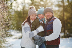 Lovely family in snowy park Royalty Free Stock Photos