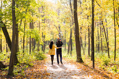 Lovely family walking in the autumn forest. Healthy lifestyle Stock Photo