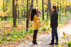 Lovely family walking in the autumn forest. Healthy lifestyle Royalty Free Stock Photo