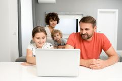 Lovely Family Watching Cartoons stock photo