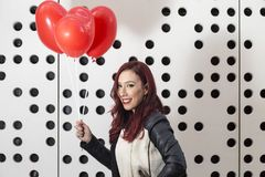Lovely fashion girl with Valentine heart balloons Royalty Free Stock Images