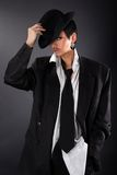 Lovely fashion model in big man shirt and coat Stock Photo