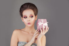 Lovely Fashion Model Woman holding Gift Stock Photography