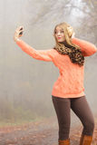 Lovely fashion woman in park taking selfie photo. Stock Image