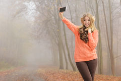 Lovely fashion woman in park taking selfie photo. Royalty Free Stock Images