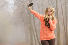 Lovely fashion woman in park taking selfie photo. Stock Photography