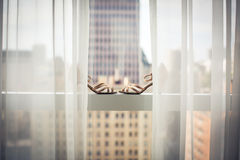 Lovely fashionable shoes of a bride on a window Stock Photos