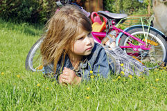 Lovely female child in garden Royalty Free Stock Image