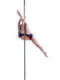 Lovely female dancer performs split on pylon Royalty Free Stock Photo
