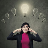 Lovely female entrepreneur with lamps Stock Image