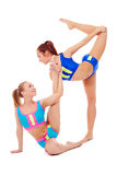 Lovely female gymnasts warming up in pair Stock Photo