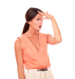 Lovely female with hand on head gesturing headache Stock Photography