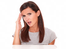Lovely female looking at camera with headache Stock Photos