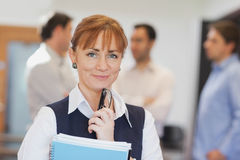 Lovely female mature student posing in classroom Royalty Free Stock Photography
