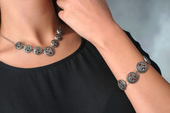 Lovely female model with jewelry on neck and hands Stock Images