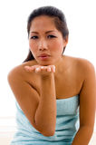 Lovely female model posing with flying kiss Royalty Free Stock Photography