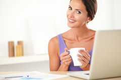 Lovely female person sitting and surfing web Royalty Free Stock Photography