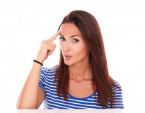 Lovely female pointing to her forehead Stock Photography