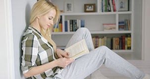 Lovely female reading at home Royalty Free Stock Images