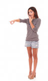 Lovely female in shorts standing up pointing Royalty Free Stock Photos