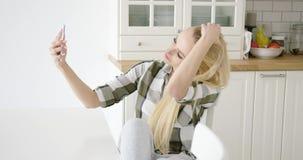 Lovely female taking selfie stock video footage